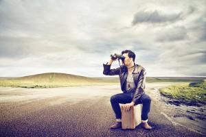 man sitting on suitcase