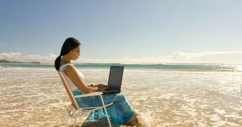 woman writing on the beach