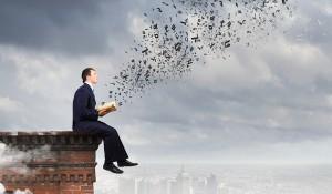 man finding a big idea in a book