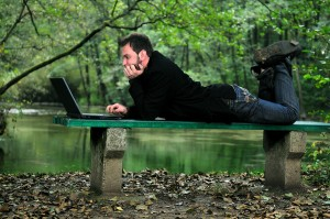 man writing outside