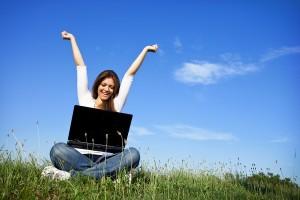 happy lead generation specialist working on laptop