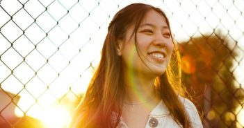 Woman smiling by fence