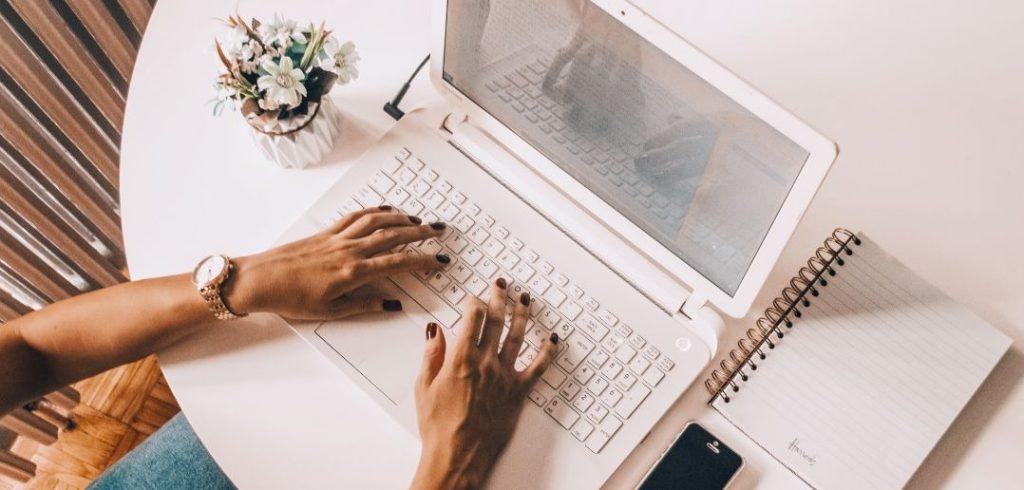 hands on laptop computer