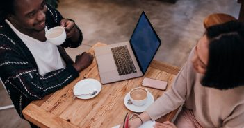 man and woman networking over coffee
