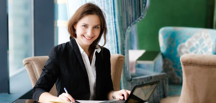 woman at a table working on a white paper