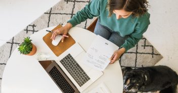 woman working on laptop with dog