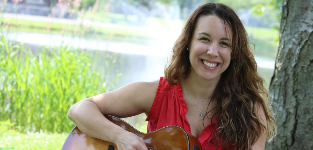 Rachael Kraft playing guitar