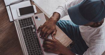 man online copywriting on laptop at home