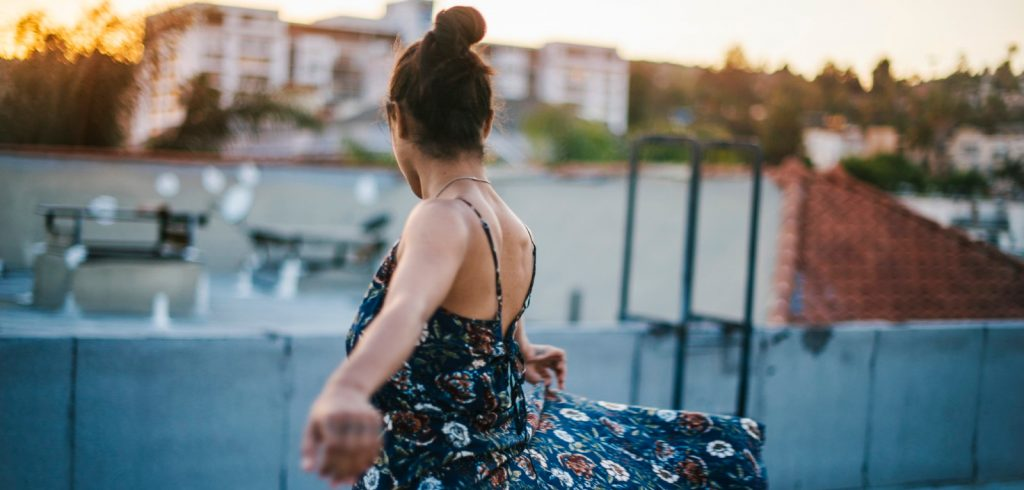 woman dancing on building rooftop
