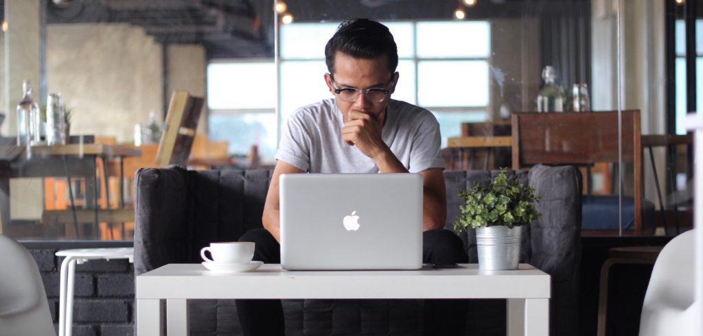 writer staring at computer with analysis paralysis
