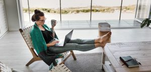 woman working on client free writing business on laptop