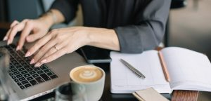 writer outsourcing to a virtual assistant on computer